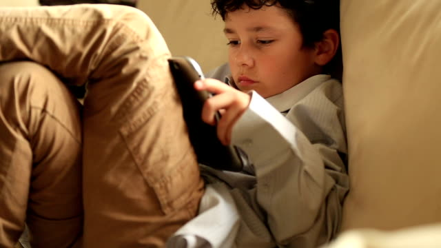 little boy relaxation with digital tablet video
