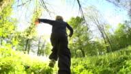 HD SUPER SLOW MO: Little Boy Running In Park video