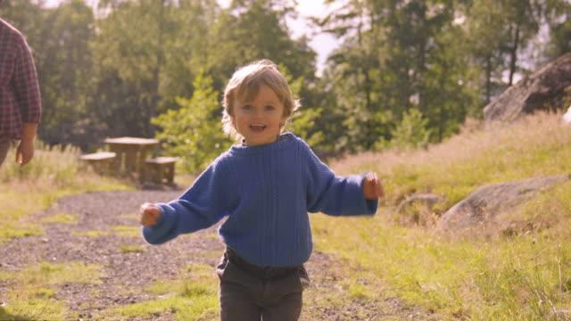 Little Boy Runs Toward Camera On Path video