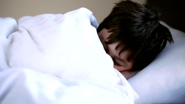 little boy sleeping restlessly video