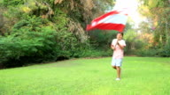 Little boy smiling and waving Austria flag outside video