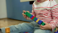 Little Boy Stacking Blocks Together video