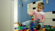 Little Boy Stacking Up Toy Blocks video