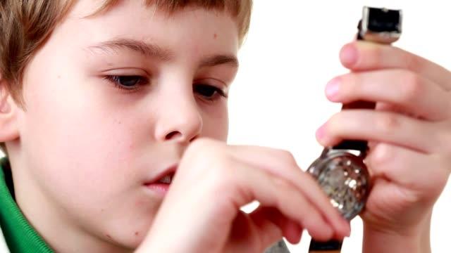 Little boy starts a wristlet watch video