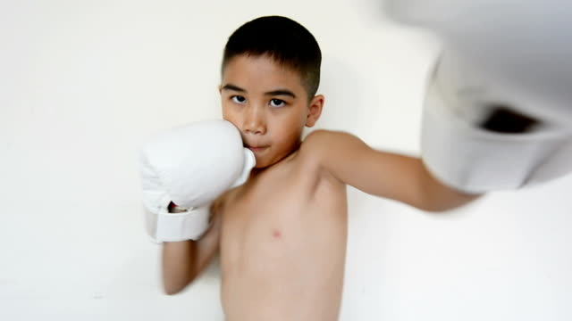 Little boy training boxing video
