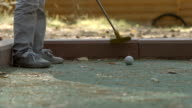 SLOW MOTION: Little boy tries to beat golf ball video