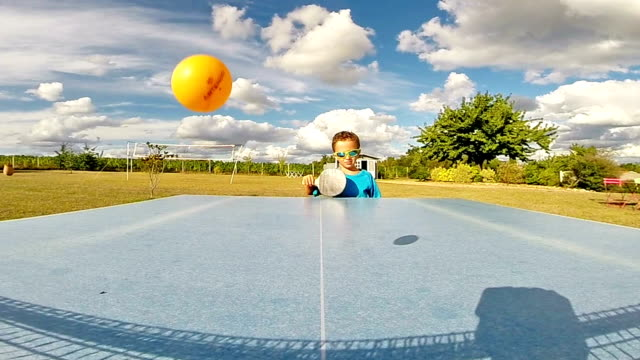 Little boy trying play Table Tennis - Slow Motion video
