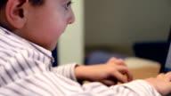 Little boy typing on laptop video