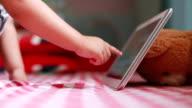 Little boy using digital tablet video