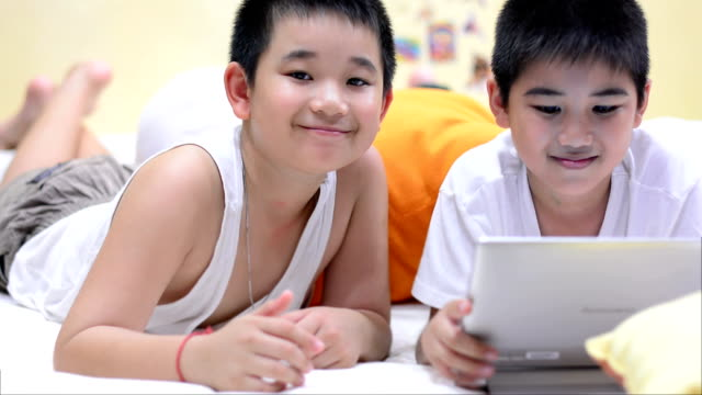 Little boy using tablet and smart phone video