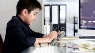 Little boy using tablet video