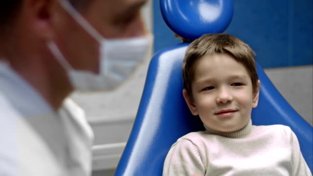Little boy visiting the dentist and looking scared video