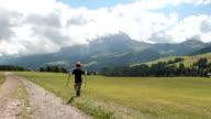 Little boy walking on Seiser Alm - Alto Adige video