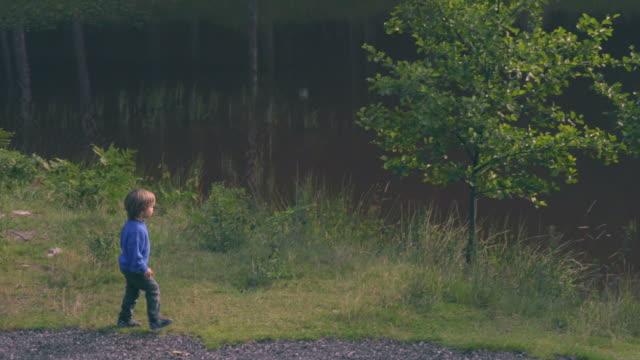 Little Boy Walks Alone By Lake video