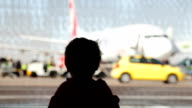 Little boy watching planes at the airport video