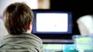 Little boy watching TV,backside view video
