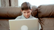Little boy watching video on the laptop computer video