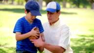 Little boy wearing a baseball glove video