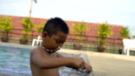 Little boy wearing goggles in swimming pool slowmotion video