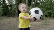 little boy with a ball in the park video