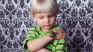 Little boy with a roman snail video