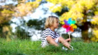 little boy with colored pinwheel video