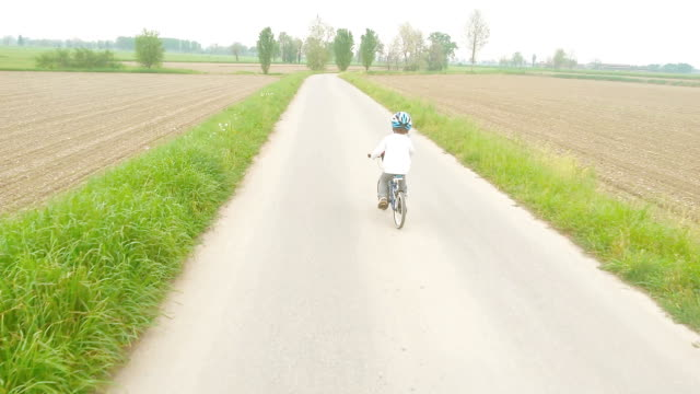 Little boy with his bicycle on country road video