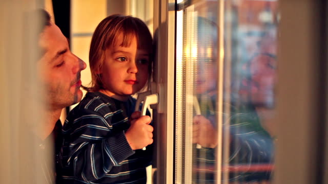 little boy with his father looks out the window video