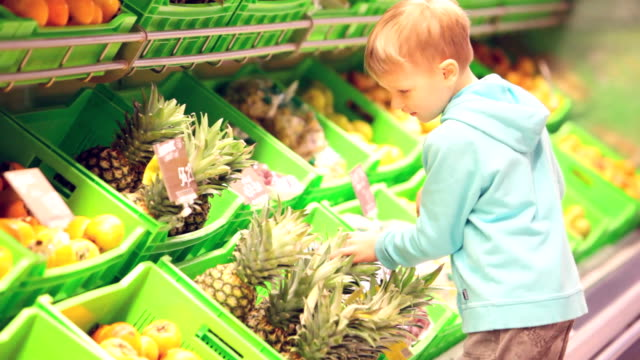 Little boy with pineapple video