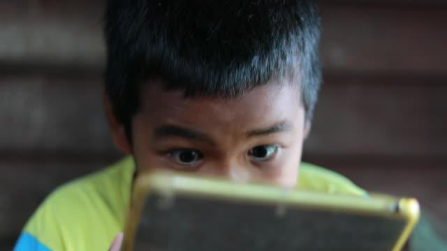 Little boys using digital tablet video
