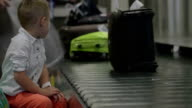 Little child at baggage claim area video