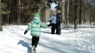 Little Child is running fast to his family in winter video