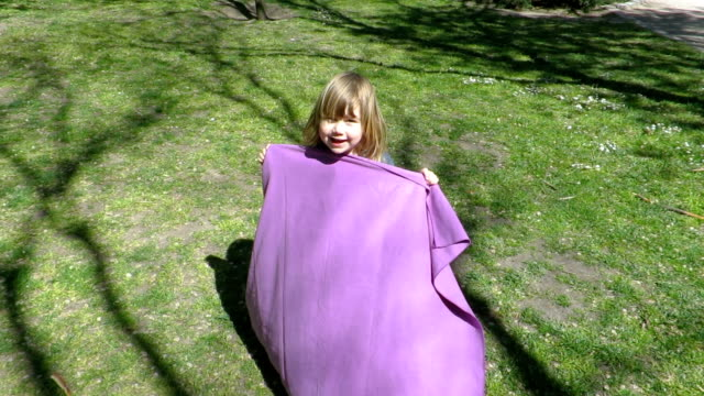 little child playing with towel at park video