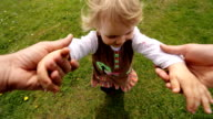Little child running on green grass and enjoying her time on the villlage. video