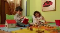 Little children, babies, educator, teacher playing in kindergarten, school video