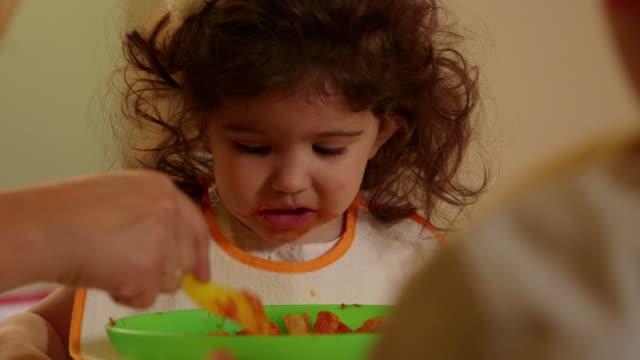 Little children, child, baby, girl eating in kindergarten, school video