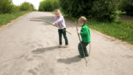 Little children plays with bug beetle on the road video