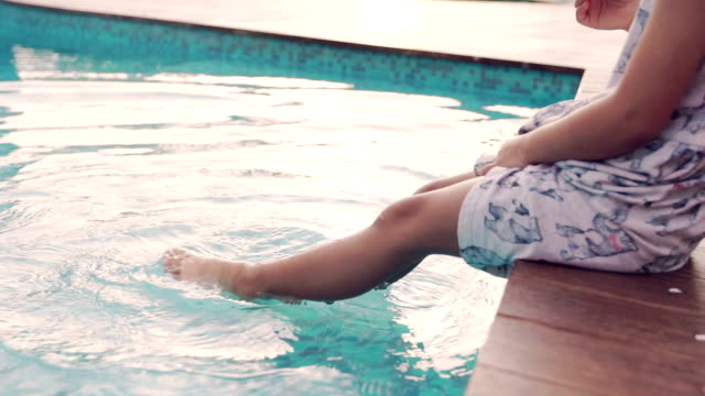 Little children sitting by the pool video