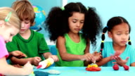 Little children using modelling clay video