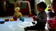 Little cute boy playing with toys in the room video
