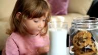 Little cute girl eating cookie video