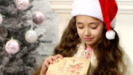 Little cute girl opening Christmas gift box video