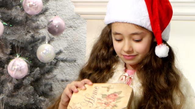 Little cute girl opening Christmas gift box video
