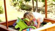 Little cute girl playing in sandbox video