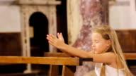 Little cute girl praing in the church video