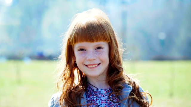 little ginger girl with freckles smiling video