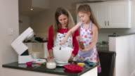 4K: Little Girl Adding Natural Sugar while Baking video