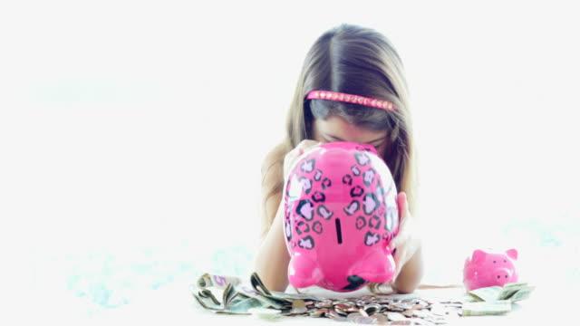 Little girl after emptying her piggy bank video