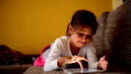 Little girl and a tablet video