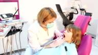 little girl and female dentist video